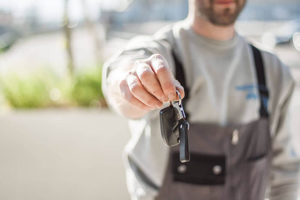 A man handing over car keys
